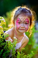 Portrait of little girl with face painted