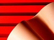 Abstract with red lines and tan wave
