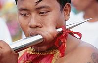 Self torturing spirit medium at the Vegetarian Festival. Phuket. South Tahiland