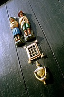 Dutch figurines and knocker on house door. Amsterdam. Holland