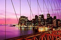 View of Lower Manhattan skyline from the Brooklyn Bridge at night. New York City, USA