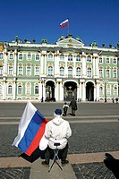 Russian flags in front of The Hermitage Museum, (Hermitage State Museum), St. Petersburg, or Saint-Petersburg, former Leningrad, Russia, at Dvortsovay...