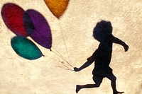 Balloon silhouette, child running