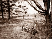 Chair or loveseat made of twigs in a landscape