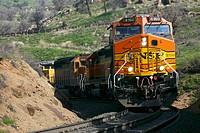 Burlington Northern Santa Fe Train heading to Tehachapi from Bakersfield. Union Pacific train traveling in through Tehachapi towards Mojave Desert. Ca...