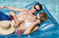 couple sunning in a pool