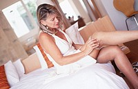 Mature woman pulling on stockings