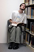 Dave, a student at the Corcoran College in Washington DC, suspiciously takes notes in the reference section of the school´s library.