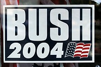 2004 presidential campaign: a Bush 2004 poster hangs in the window of a Washington DC business.