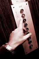 Hand in an elevator.