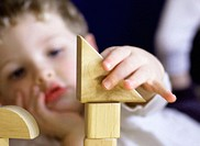 Boy concentrating on building blocks