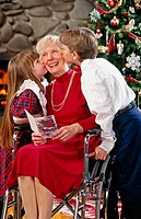 Children giving Grandma Christmas kisses