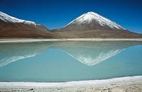 Licancabur Volcano and Esmeralda lagoon. Bolivian Plateau.