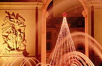 Arc de Triomphe replica and Christmas tree at Paris Hotel and Casino, fountains at fore. Las Vegas. Nevada, USA