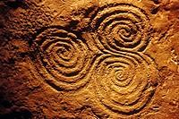 Spiral pattern (c. 3200 b.C.) in Newgrange archeological site. Co. Meath, Ireland
