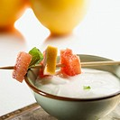 Bowl of yoghurt with grapefruit and mint brochette