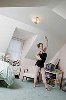 Teen girl age 17 in bedroom, ballet dancing student