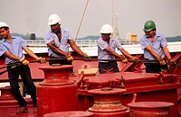 Line handlers on ship. Panama Canal. Panama.
