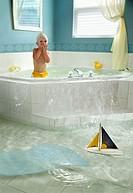 4 year old boy overflowing bathtub.