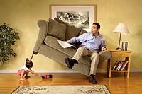 Girl lifting sofa.