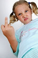 Angry little bottom view makes a rude gesture showing her middle finger