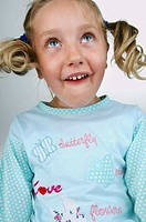 Little girl with pigtails bottom view makes some funny faces