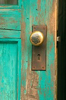 Door knob on wooden door.
