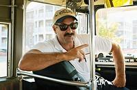 WISCONSIN. Kenosha. Restored streetcar, driver wearing baseball cap, turned around in seat, windshield