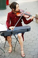 Asian woman playing the violin