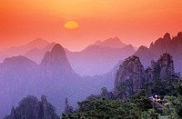 Sunrise, Chinese people, tourists are watching the sunrise. Huangshan mountains. China.