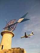 Windmill and airplane landing. Son Sant Joan airport. Palma de Mallorca. Balearic Islands. Spain.