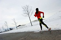 Female jogger in winter with snow