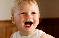 Baby boy smiling portrait