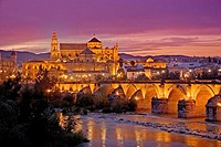 Guadalquivir river, Roman bridge and mosque-cathedral in the evening. Córdoba. Andalucia. Spain.
