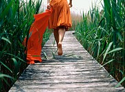 A woman takes a stroll down a pier in Mattituck, NY. She carries the red sarong. USA