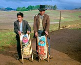 Two young Mapuche Indian boys in southern Chile near Temuco display babies in traditional indian garb. Mapuches are the original Amerindian inhabitant...