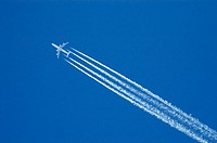 A passenger jet leaves contrails on its way across the sky .(USA)