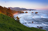 Ecola State Park overlooking Canon Beach, Oregon, at sunset.