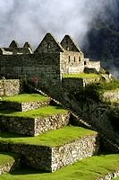 Woman on stairs at Machu Picchu
