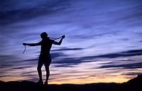 Male climber at sunset . Peñarroya de Tastavins. Teruel. Aragón. Spain