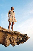Woman on a sandstone rock formation. Formentera. Balearic Islands. Spain.