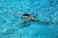 Woman diving in cristal water. Illetes beach. Formentera. Balearic Islands. Spain.