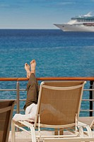 Woman resting on a deck, Cozumel, Mexico