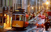 Electrico in the streets of Baixa in Lisbon at twilight, Portugal
