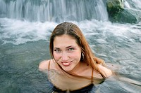 Young Russian woman enjoying hot springs in Yellowstone National Park, Wyoming. USA.