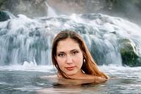 Young woman enjoying hot springs