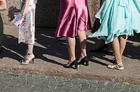 Women legs in a wedding party. St Petersburg. Russia