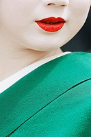 Geisha in traditional make-up and wearing a kimono in the Gion district of Kyoto, Japan.
