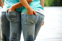 girl 13 girl 18 standing together with hands in each others jean pockets