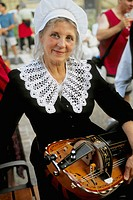 France, Périgord, Sarlat, Bastille Day, lady with traditional musical instrument